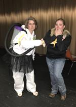 Principal dresses as test buster.