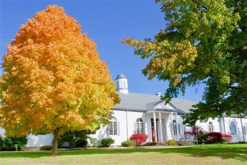 Administration Building in the fall with trees turning colors