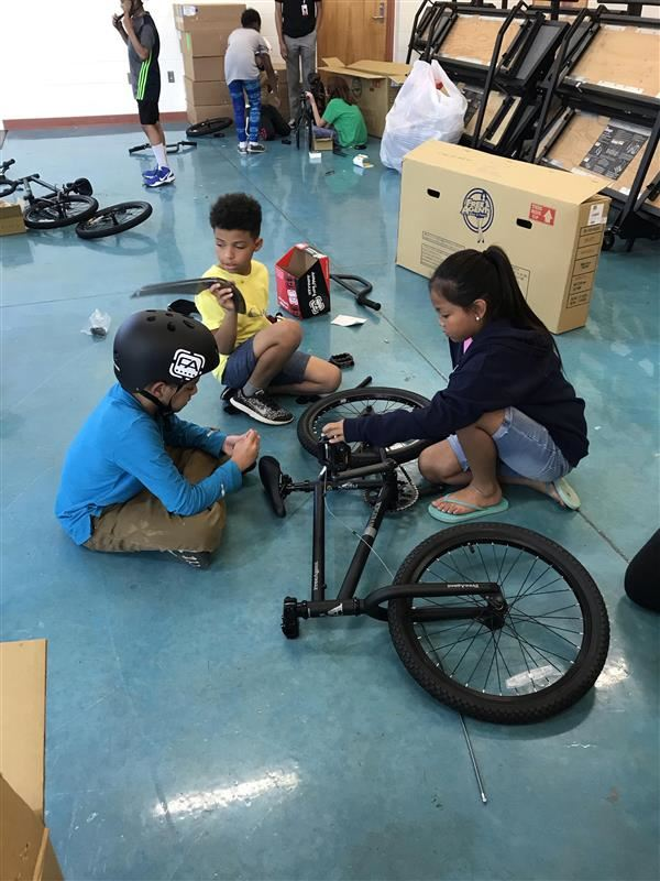 Freedom Elementary students assemble bicycles
