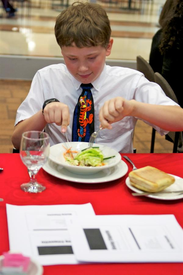 12 sixth graders interview and participate in etiquette lunch