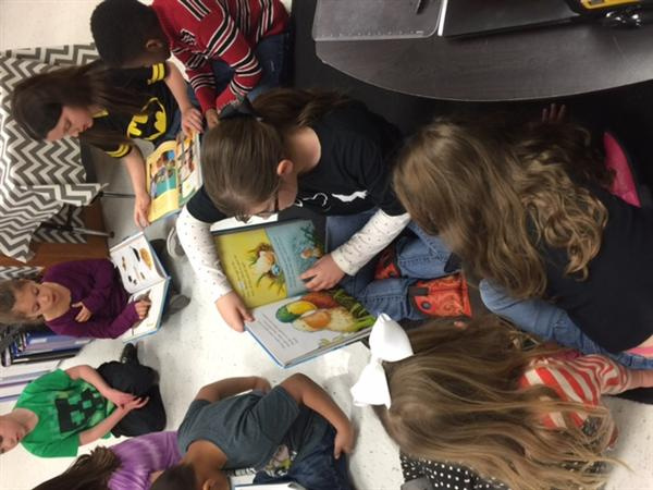 1st graders read to kindergartners at East