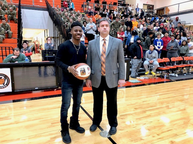 Coach Pilz presents basketball to Joe Johnson III