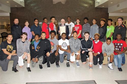 State Rep Lynch presents resolutions to WHS boys BB team