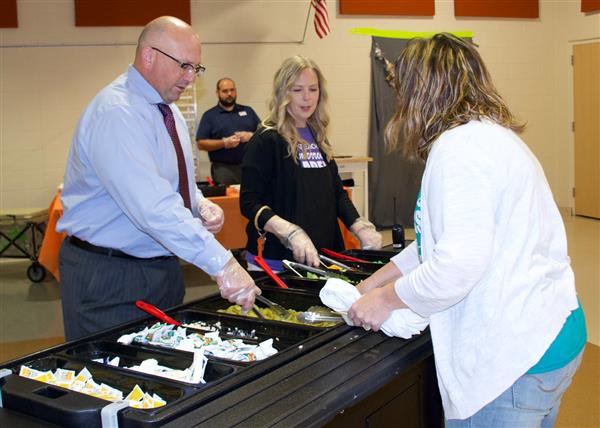 Administrators serve up lunch to staff and students