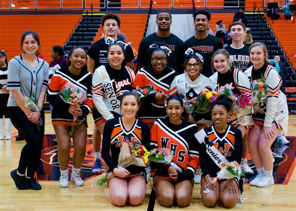 WHS senior boys basketball players and senior cheerleaders and dance team members recognized