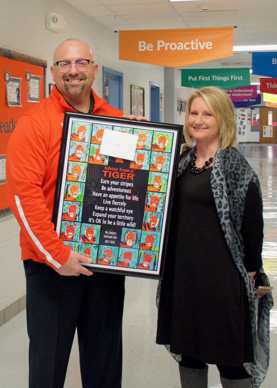 Thayer Elementary principal presents artwork to Dr. Henry