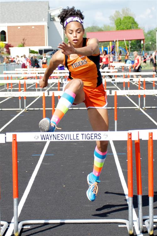 Okorie takes 1st in state, sets school records